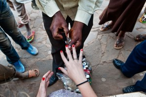 Making money in Africa, boys do the nails